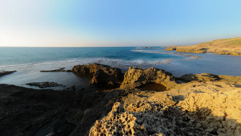 Time lapse of rocky Israeli coast while sun sets Footage