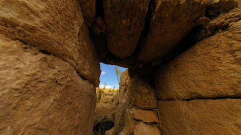 Time-lapse moving through a door in ancient ruins Footage
