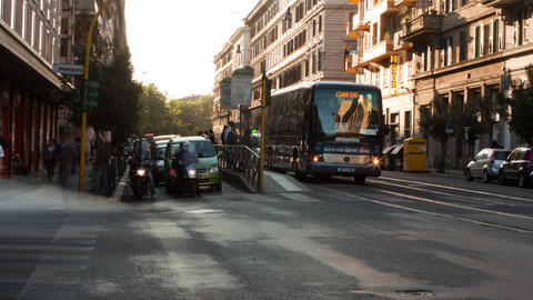 Time-lapse of a busy street and city trolley stop in Rome Footage