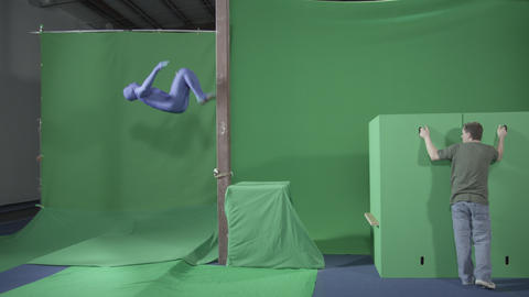 Slow motion green screen shot of a man doing ninja stunts Footage