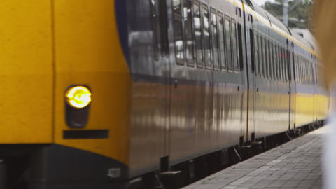 Static shot of train arriving at a train station in Amsterdam Footage