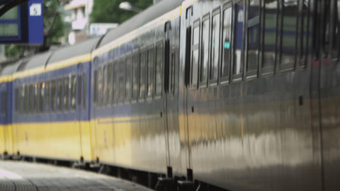 Static shot of train leaving the train station in Amsterdam Footage