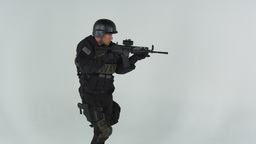 Shot of soldier entering at left pointing assault rifle. Shot in slow motion aga Footage