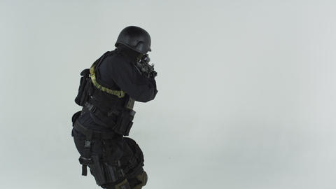 Shot of S.W.A.T. entering left with an assault rifle. Shot in slow motion agains Live Action