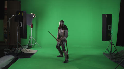 Front Shot of man in chain mail with sword in hand. shot in slow motion against  Footage