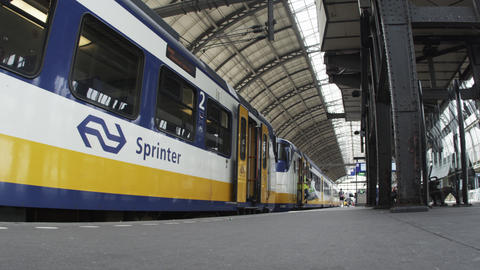 Timelapse shot of a train and its passengers in a train station in Amsterdam Footage