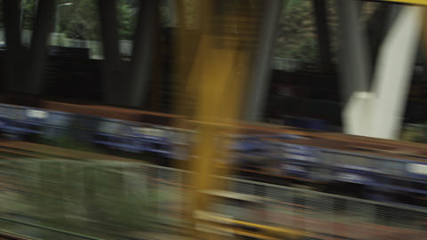 Tracking shot of buildings and pallets alongside train tracks in Amsterdam Footage