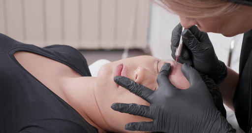 Parallax shot during a tattoo removal process performed in a beauty salon Footage