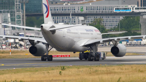 China Eastern Airbus A330 towing Live Action