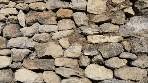 The stone fence is made of crude stone Footage