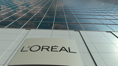 Signage board with L'Oreal logo. Modern office building facade time lapse Footage