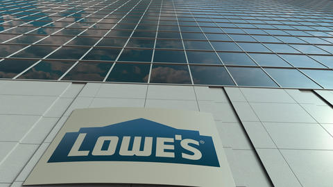 Signage board with Lowe's logo. Modern office building facade time lapse Live Action