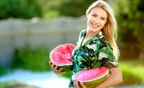 Beautiful happy girl with slice of ripe water-melon Photo