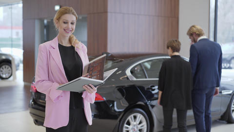 Portrait of pleasant woman in pink jacket looking in big book with information Footage