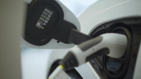 Plug in electric power to the car. New era of vehicle... Stock Video Footage