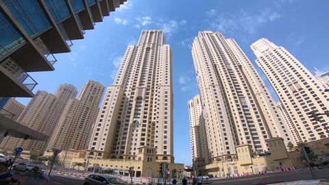 Walking on the sidewalk and Tall towers POV Live Action