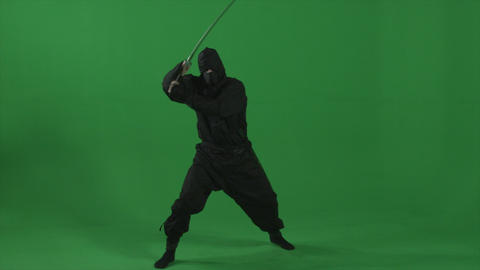Ninja does slashing and kicking moves in studio Footage