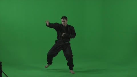 Ninja dressed in black does combination jabs Footage