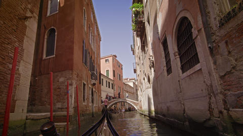 View from a gondola as it glides through a back alley canal Footage