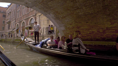 Gondolas ride under a footbridge in slow motion Footage