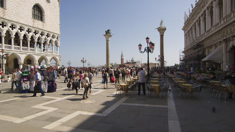 Slow motion shot of people entering and exiting Piazza San Marco Footage