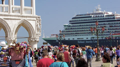 Slow motion shot of cruise ship pulling up near Piazza San Marco Footage