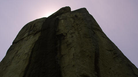 Low angle footage of enormous rock Footage