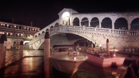 Motor boats docked by Rialto Bridge Footage