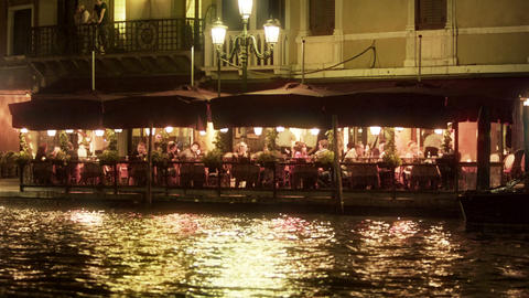 Restaurant seating area ont he waterside at night Footage