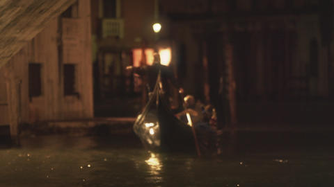 Gondolier paddling boat at night Footage