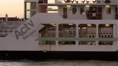 Static shot of a ferry going by Piazza San Marco in the canal Footage