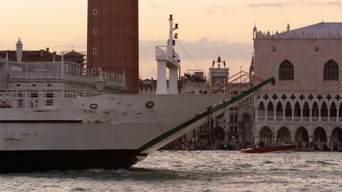 Static shot of a the end of a ferry going by Piazza San Marco in the canal Footage