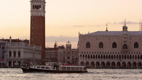 Tilting down shot of Piazza San Marco to the wharf and a vaporetto Footage