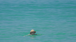 Woman swimming in the ocean Footage