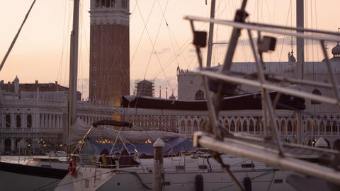 Static shot of Piazza San Marco and the Doge's palace seen through sailboats Footage