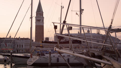 Static shot of Piazza San Marco and the Doge's palace seen looking through sailb Footage