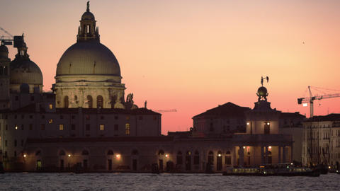Static shot of Santa Maria della Salute and boats in the canal at sunset Footage