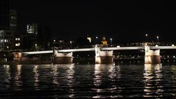 River and Illuminated Footbridge at Night Footage