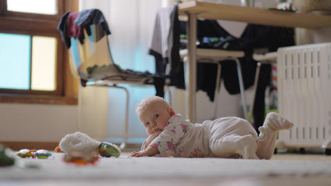 Eight months child on the floor at home Live Action