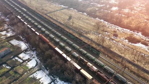 View from the height on long container freight train transporting goods across Live Action
