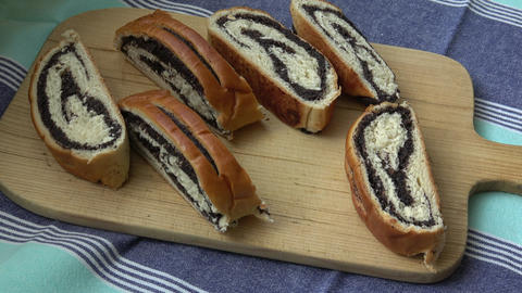 Cut tasty sweet bun with poppy seeds Footage