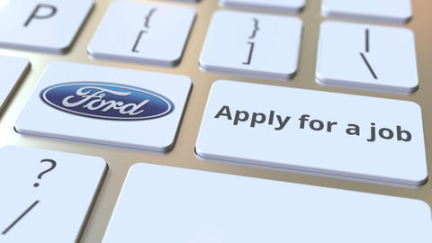 Computer keyboard with FORD logo and Apply for a job text on the keys. Editorial Footage