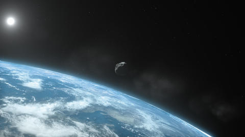 Asteroid approaching Earth with Sun and stars Stock Video Footage