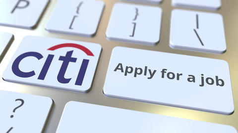 CITIGROUP company logo and Apply for a job text on the keys of the computer Footage