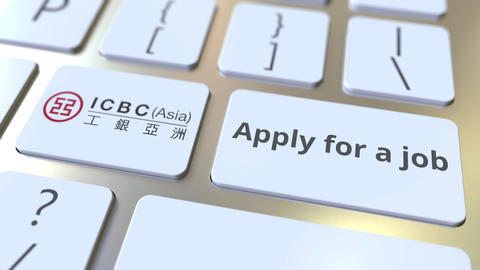 Keyboard with ICBC company logo and Apply for a job text on the keys. Editorial Live Action