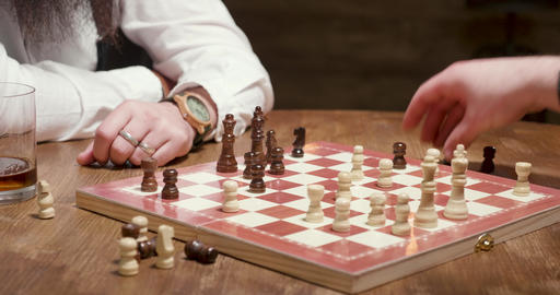 Man gets a checkmate during a chess game Footage