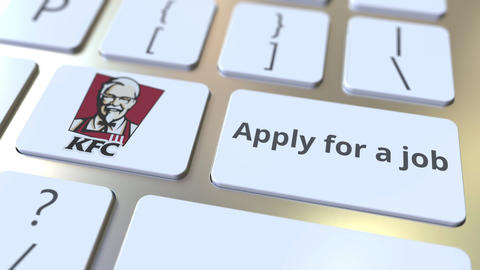 Computer keyboard with KFC logo and Apply for a job text on the keys. Editorial Live Action