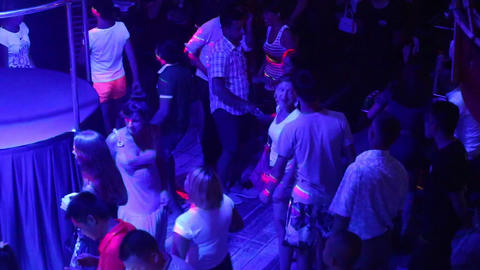 joyful clubbers dance on nightclub floor by stage Footage