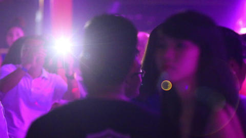 joyful people rest and dance at neon light in night club Footage