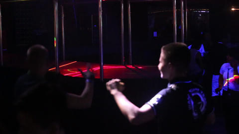 clubbers dance and have fun on dance floor in neon lights Footage